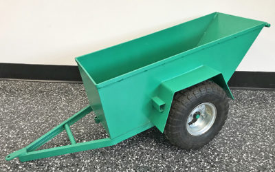 """Kids are fascinated by material handling equipment. So we fabricated a tiny version of a dumpster trailer for """"Santa"""" to give to their grandson for Christmas."""